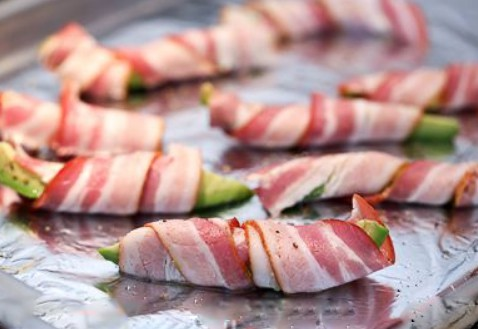1. Stage. Preheat oven to 425º. Slice each avocado into 8 equally-sized wedges. Wrap each wedge in bacon, cutting bacon if needed. Place on a baking sheet, seam side down.