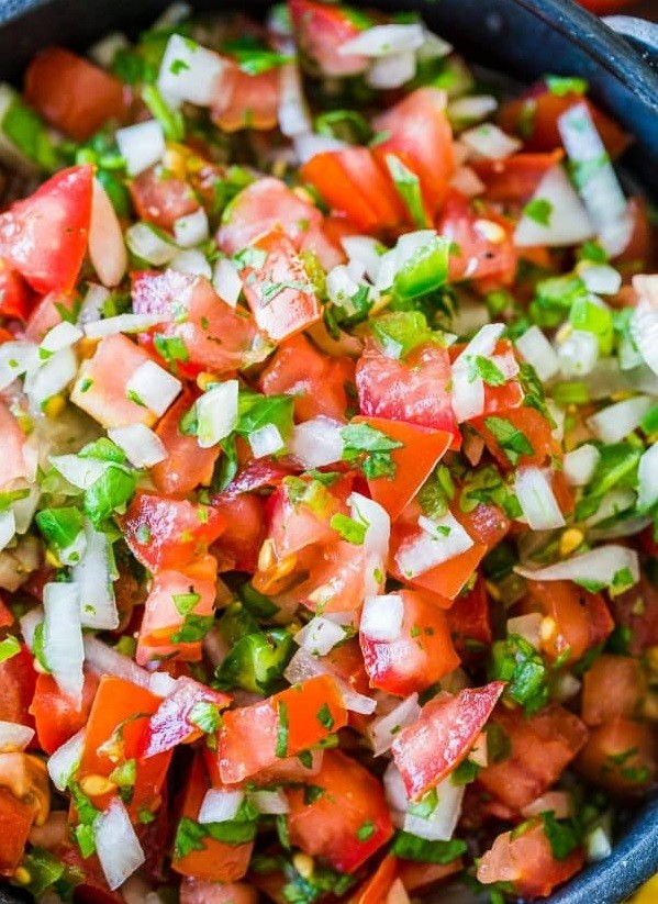 1. Stage. Salsa Fresca is often served as a topping for breakfast foods, enchiladas, tacos, nachos and more. It is so versatile! It's also perfect as an appetizer with chips.
