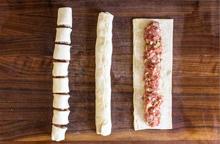 1. Stage. Unfold both puff pastry sheets and cut each into thirds (follow the perforations). Divide the pork mixture into 6 equal parts. Roll the divided pork into sausage shapes, equal to the length of the puff pastry strip. Lay each sausage in the middle of each puff pastry strip.