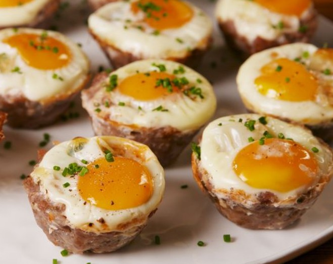1. Stage. Bake until eggs are set and sausage is cooked through, about 25 minutes. Garnish with chives and serve.