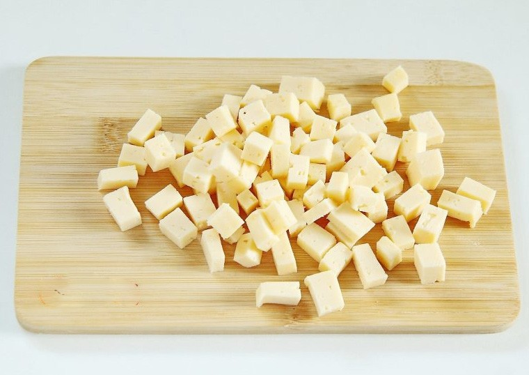 1. Stage. Cut the cheese into cubes as well.