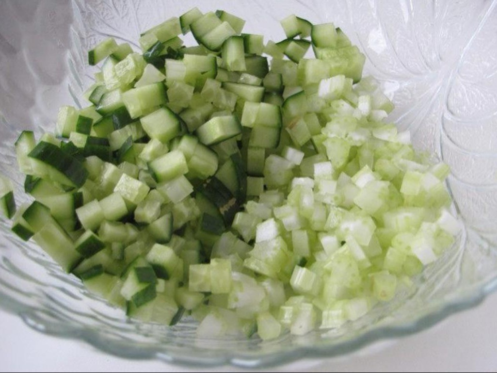 1. Stage. Dice the cucumber and celery stalks.