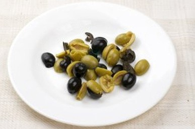 1. Stage. Cut olives into halves.