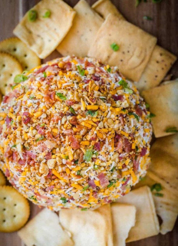 1. Stage. Form a ball out of the cheese mixture and roll the cheese ball over the toppings to fully coat and shape into an even ball as it's coated. Serve right away or cover and refrigerate until ready to serve.