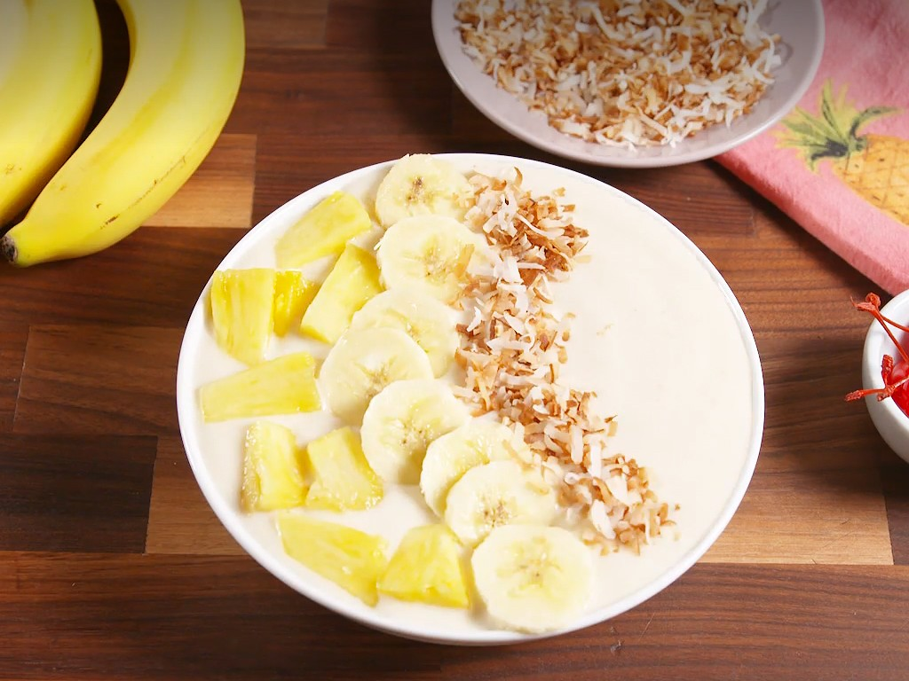 1. Stage. Pour into a large bowl. Arrange more pineapple, banana slices and coconut on top. Garnish with maraschino cherry, if desired.