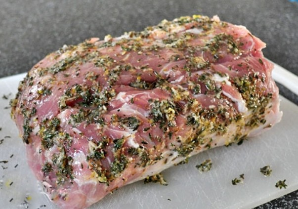 1. Stage. In a bowl, mix salt, pepper, thyme, garlic passed through a press, oil and lemon zest. Using the prepared mixture, rub the meat on all sides.