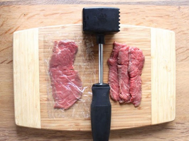 1. Stage. Rinse the beef, dry it with a paper towel and put in the freezer for 1 hour. Then cut the meat into thin slices of about 3-6 mm, each piece beat off with a hammer.